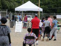 "People wait in line to be tested for coronavirus at a free testing site in Dallas, on Thursday, May 28, 2020. This is the first of five proposed free coronavirus testing sites in Dallas' southern sector as part of Project Unity's ""Together we Test"" program. ""Together We Test,"" is a citywide collaboration of ministers, community leaders, health professionals, volunteers and churches with a a goal of eliminating the spread of coronavirus."