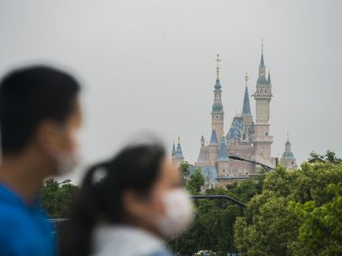 Tourists are shown at Disney town on May 05 in Shanghai, China.