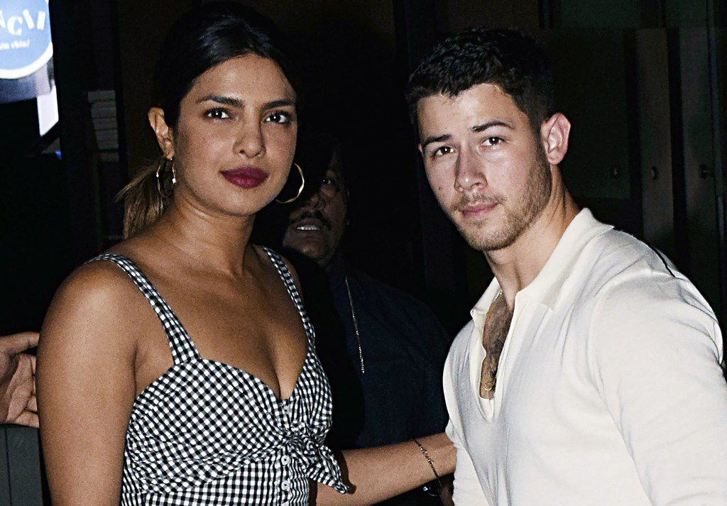 """In this file photo taken on June 22, 2018, actress Priyanka Chopra and singer Nick Jonas stand together in Mumbai. Chopra is engaged to Jonas after a whirlwind two months of dating, """"People"""" magazine, citing unnamed sources close to the pair, reported on July 27, 2018."""