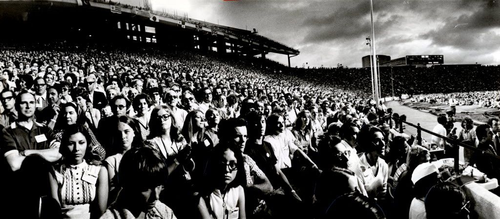 Explo '72 delegates jammed the Cotton Bowl stands and overflowed onto the turf Tuesday night  to listen to evangelists the Rev. Billy Graham and the Rev. Bill Bright, founder of Campus Crusade for Christ International.  The turnstile count was 70,462.