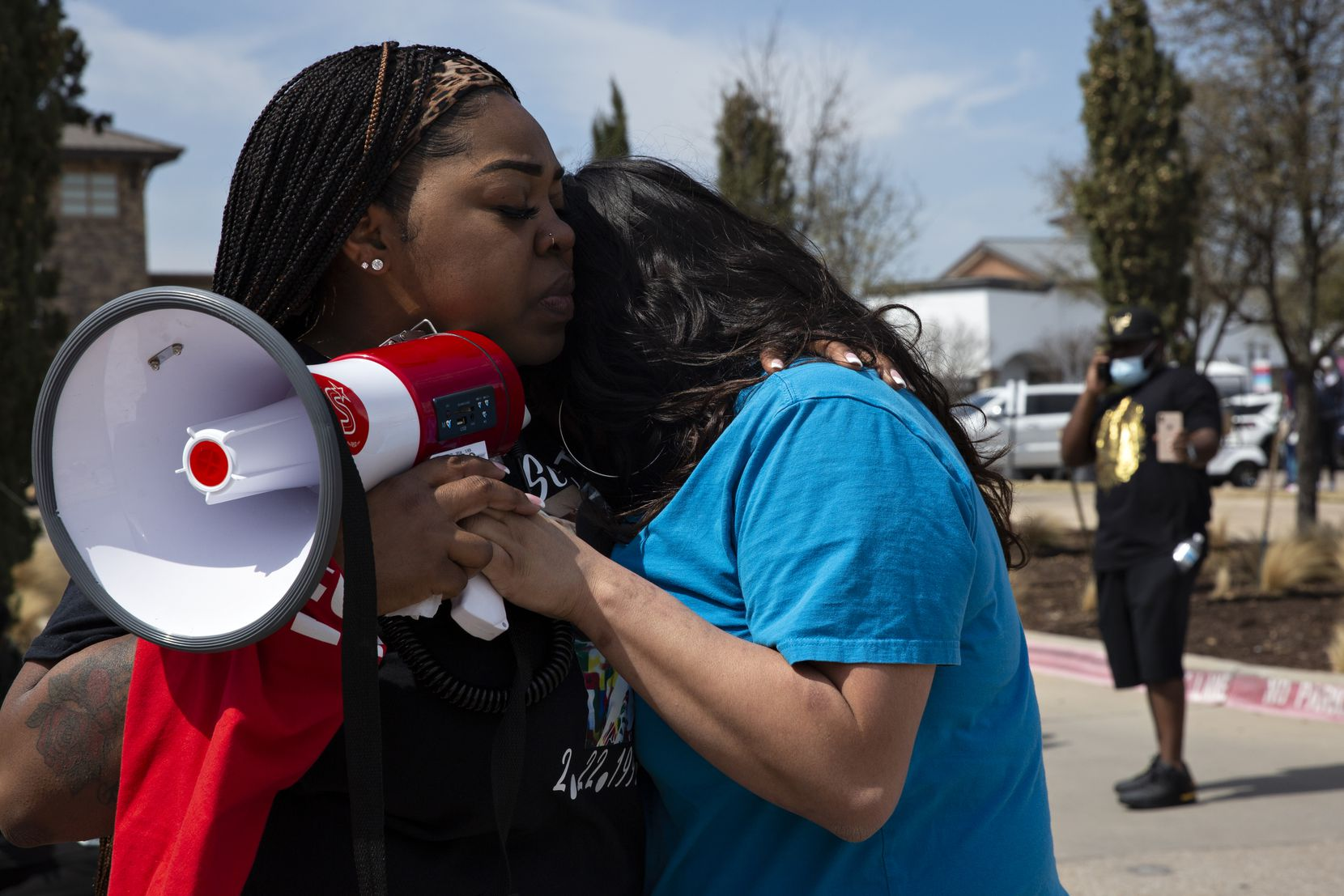 LaChay Batts comforts Monica Diaz after Monica spoke about one of her best friends Marvin Scott III, who died a week prior while in custody at the Collin County Jail on March 14, 2021. Friends and family of Marvin organized a march through the Allen Outlets on Sunday, March 21, 2021, where he was arrested. Monica spoke about MarvinÕs seemingly endless kindness, crying as she told the crowd ÒEven when I was at my worst, he told me I was beautiful.Ó (Shelby Tauber/Special Contributor)