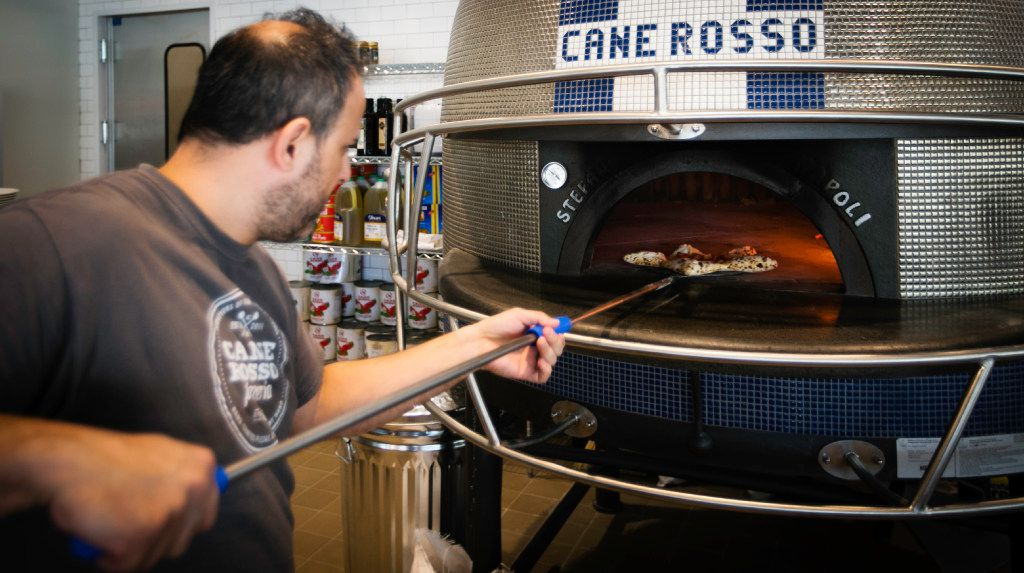 Order a pizza and a pizzaiolo will pull it out of Dallas Cowboys helmet-shaped oven at Cane Rosso in Frisco.