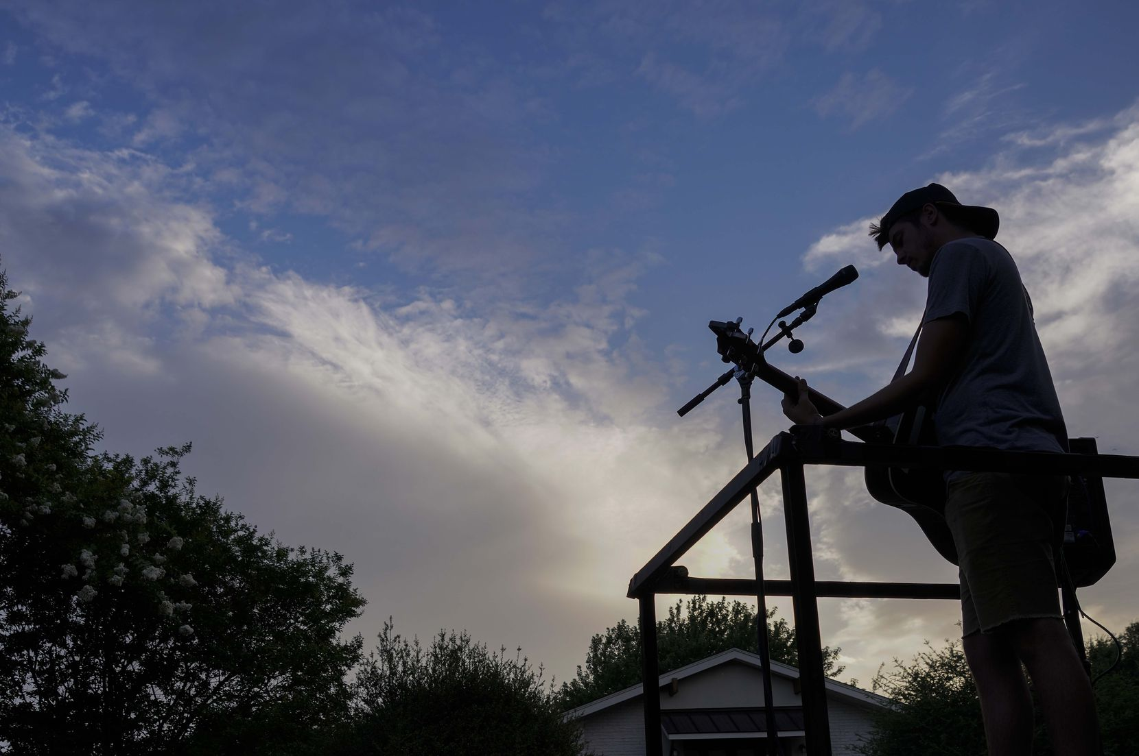 Cameron Havens sings from the back of a pickup truck during a 'Drive By Concert'  through the Canyon Creek subdivision on Thursday, July 2, 2020, in Richardson.
