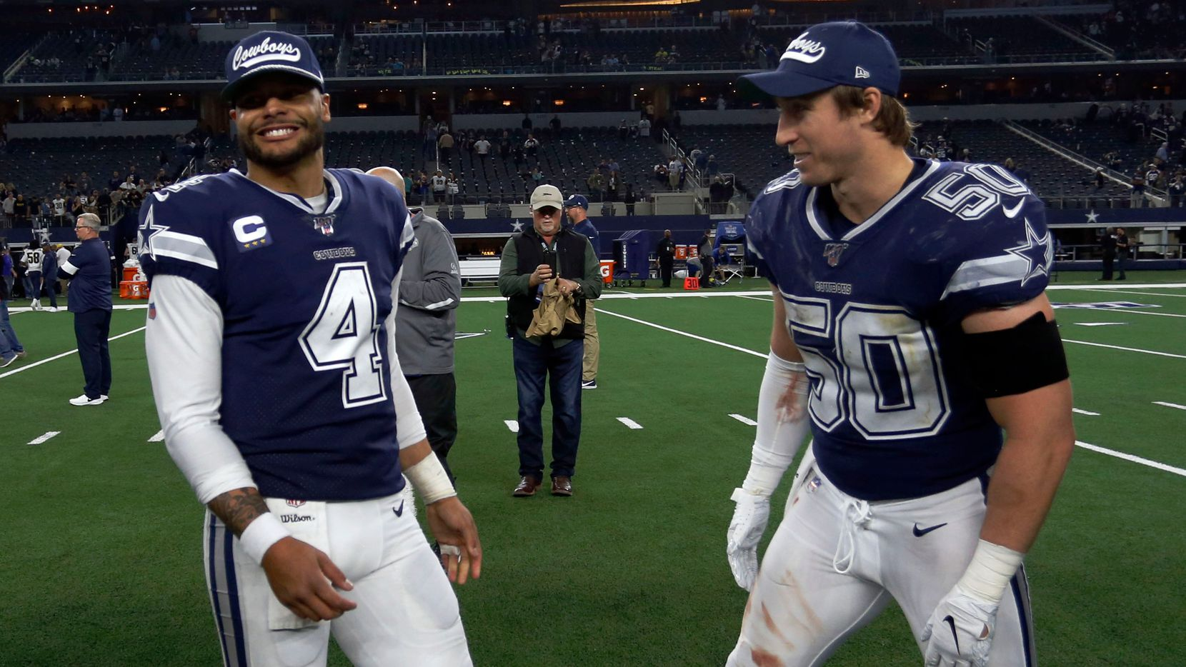 FILE — Dallas Cowboys quarterback Dak Prescott (4) and Dallas Cowboys outside linebacker Sean Lee (50) are all smiles after television interviews at the end of the Los Angeles Rams Vs. Dallas Cowboys NFL football game on Sunday, December 15, 2019. Dallas won 44-21.