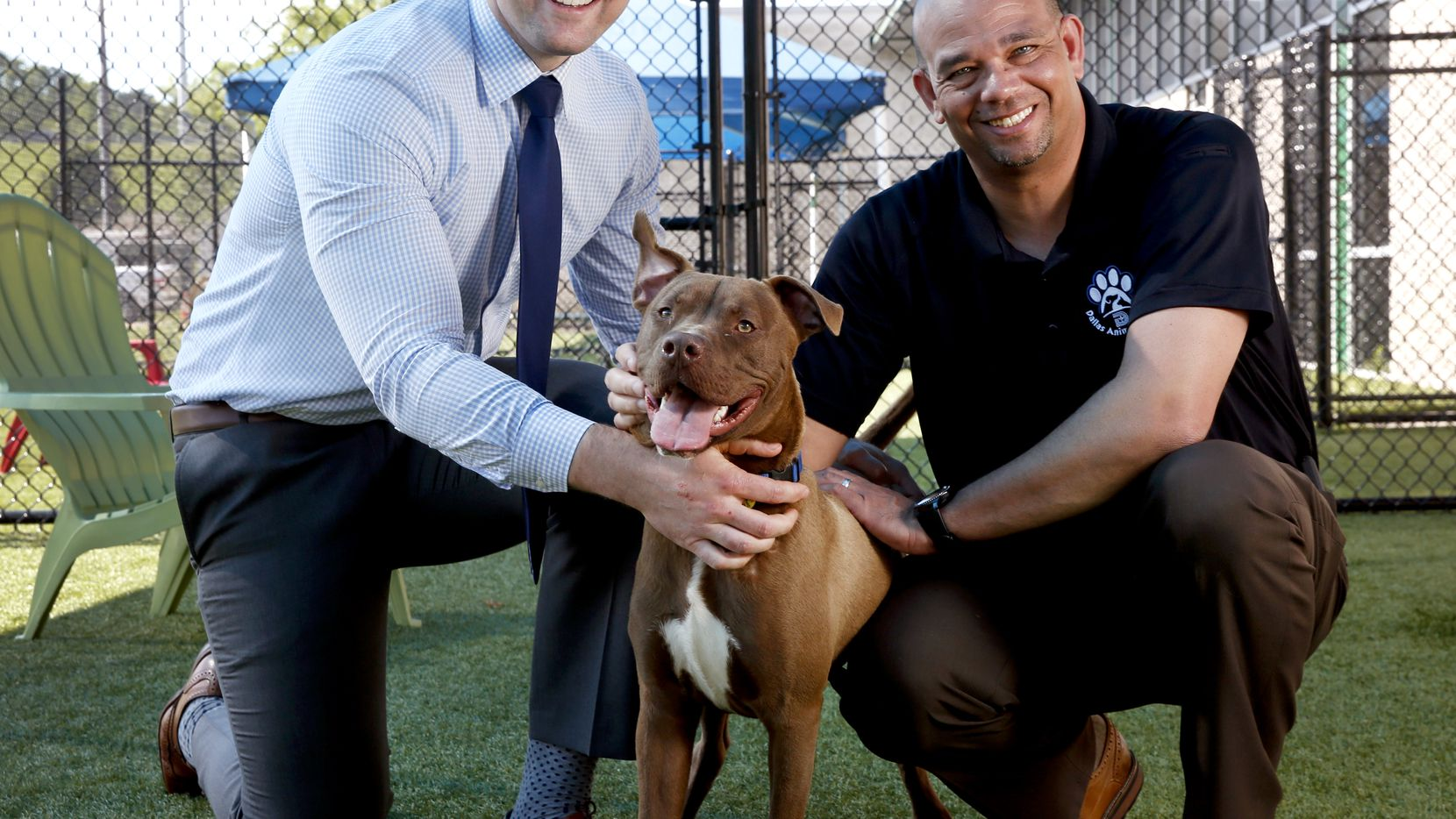 Ed Jamison (right), director of Dallas Animal Services, and Ryan Rogers, assistant director of Dallas Animal Services, with shelter dog Roger in one of DAS' outdoor play yards at the West Dallas facility.