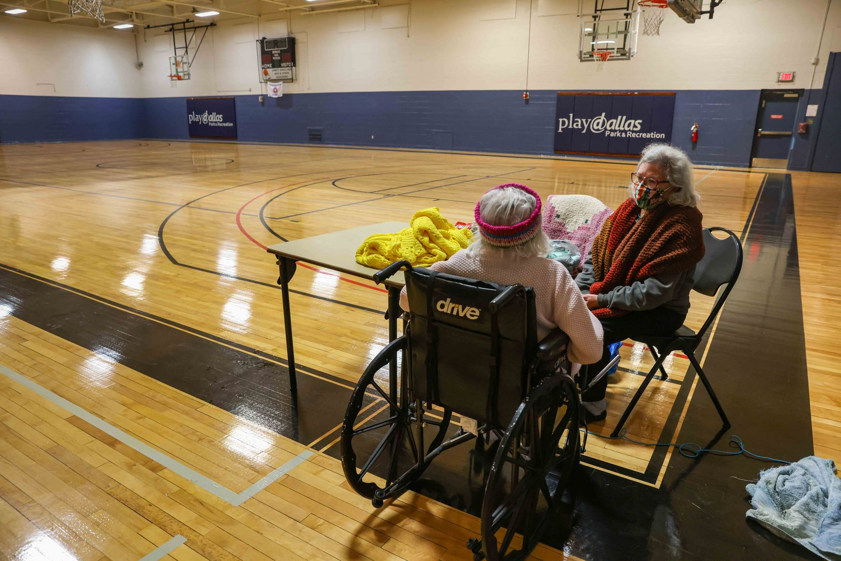 Gloria Sanders, 76, and her mother Maria Barajas, who is 100 years old and has severe dementia, both spend the day at the Pleasant Oaks Recreation Center to warm up in Dallas on Wednesday, February 18, 2021. Sanders and Barajas house has been without power since early Morday after the blizzard hit Texas last Sunday. (Lola Gomez/The Dallas Morning News)