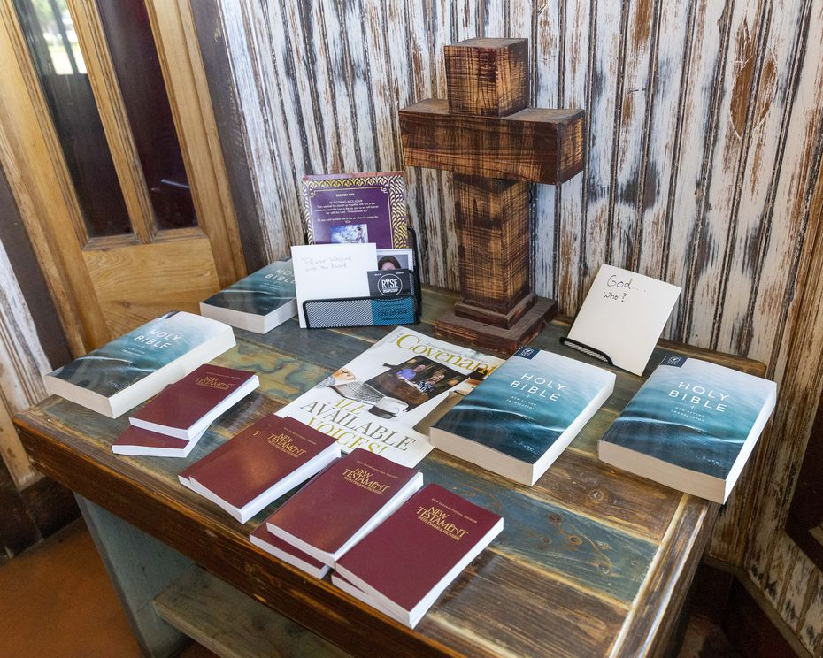 Copies of the Bible and the New Testament sit on a table in the entrance at Baker's Ribs in Weatherford, Texas. The books are free for customers to take.