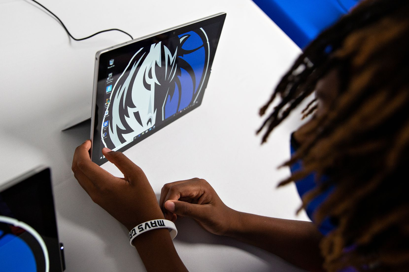 Sam Patterson, 11, sees what there is to explore on the iPads available to youth at the Mavs Foundation's unveiling of its newest reading and learning center renovation at the Moorland YMCA at Oak Cliff on August 3, 2021. Shelby Tauber / Special Contributor)