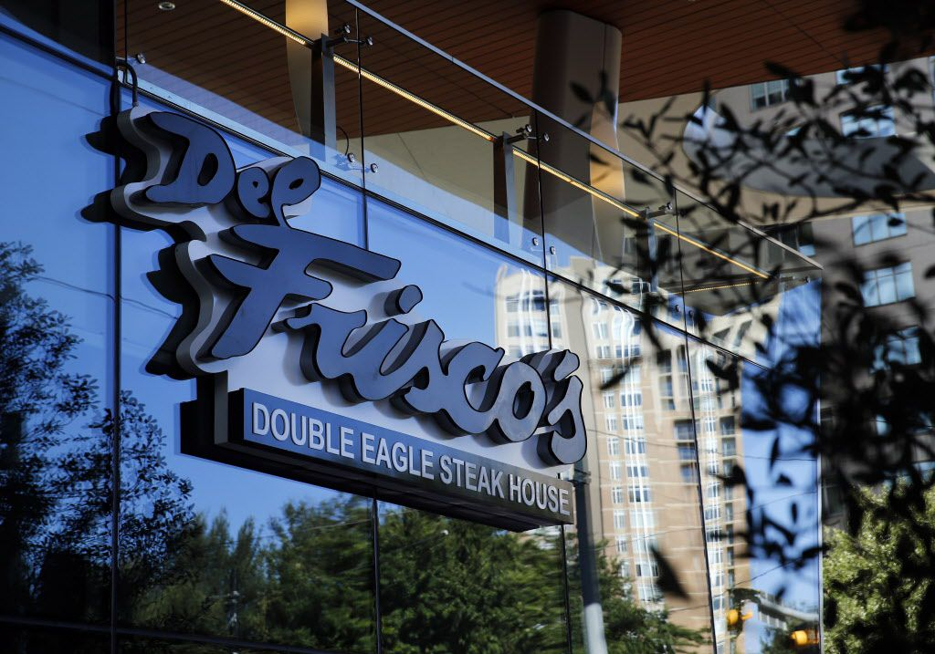 Buildings in Uptown Dallas are reflected in the exterior windows of the new Del Frisco's Double Eagle Steak House on Olive St., Friday, September 9, 2016. The original, located on Spring Valley since 1994, has closed and the new one opens Saturday. (Tom Fox/The Dallas Morning News)