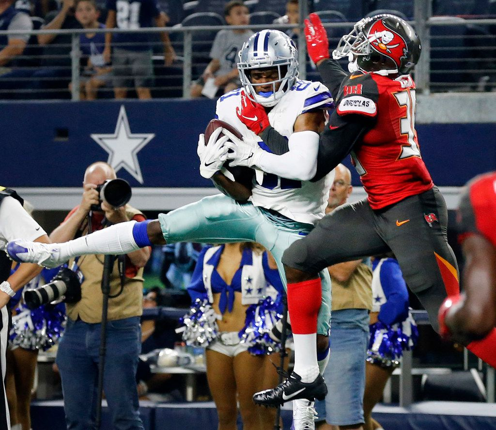 FILE - Cowboys wide receiver Jon'Vea Johnson (81) makes a leaping catch while defended by Buccaneers defensive back Jamel Dean (35) during the second quarter of a preseason game at AT&T Stadium in Arlington on Thursday, Aug. 29, 2019. The play was called back on a penalty.