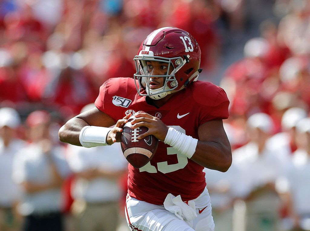 TUSCALOOSA, ALABAMA - SEPTEMBER 28:  Tua Tagovailoa #13 of the Alabama Crimson Tide looks to pass against the Mississippi Rebels at Bryant-Denny Stadium on September 28, 2019 in Tuscaloosa, Alabama.