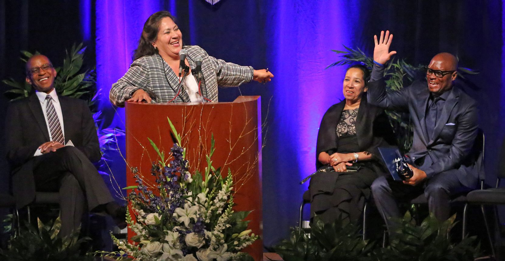Dallas Mayor Pro tem Monica Alonzo jokes with former Dallas Police Chief David O. Brown during his retirement ceremony, as master of ceremonies Willis Johnson, left, and Brown's wife Cedonia, second from right, enjoy the festivities.