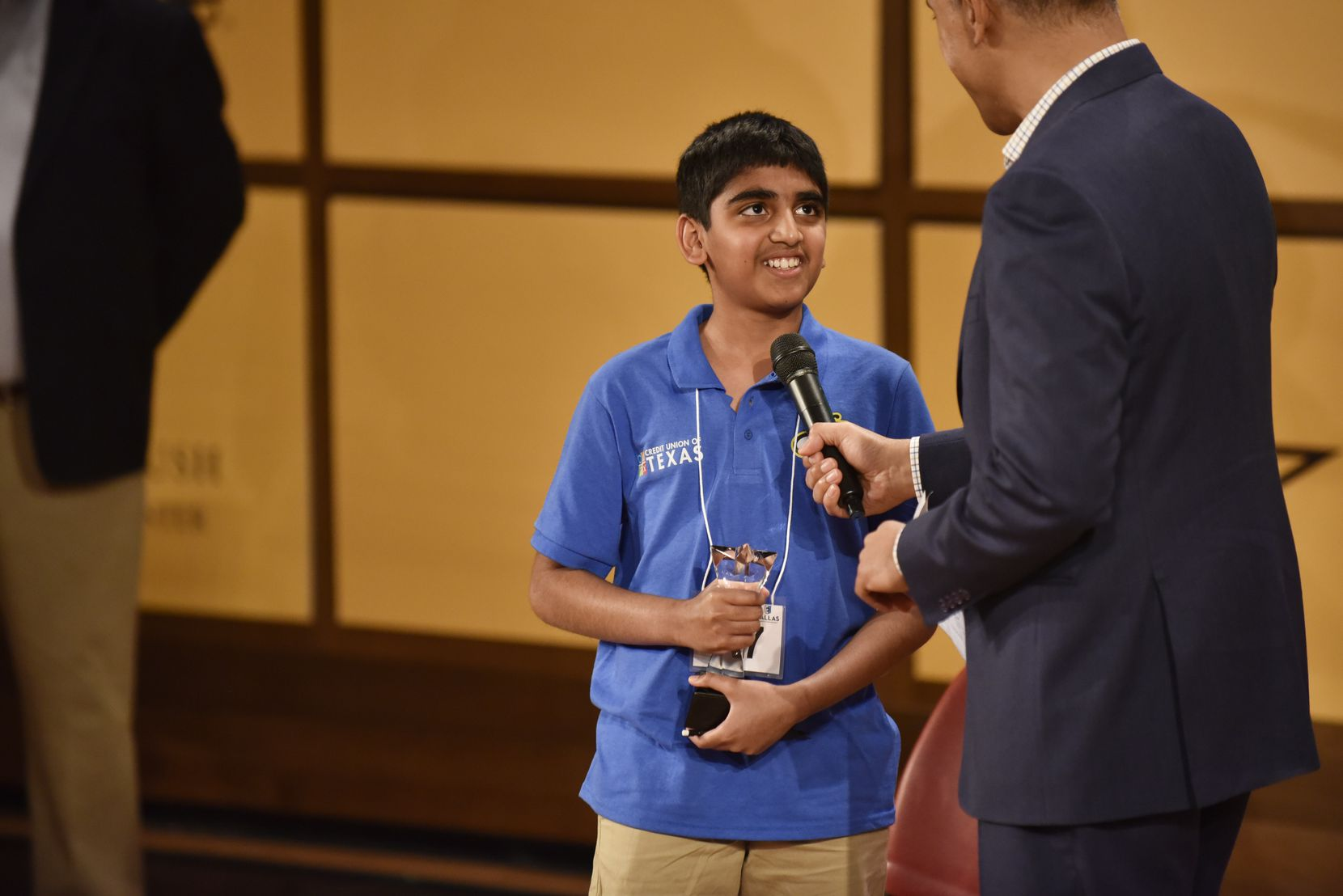 Abhijay Kodali, of Denton County, reacts with a smile as he's interviewed by WFAA news anchor Chris Lawrence after winning first place at the 61st annual Golden Chick Dallas Regional Spelling Bee at the George W. Bush Presidential Center on the campus of Southern Methodist University in Dallas, Saturday, March 09, 2019.