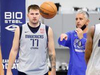 Dallas Mavericks guard Luka Doncic (77) listens to assistant coach Igor Kokoskov during a practice at the Dallas Mavericks Training Center on Tuesday, Oct. 19, 2021, in Dallas.