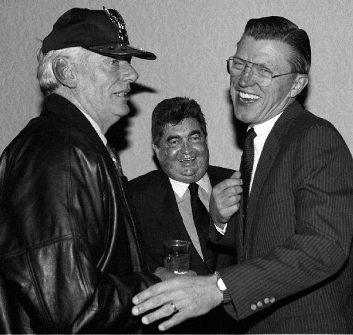 Herb Kelleher , president  of Southwest Airlines (left) and Bob Crandall, president of  American Airlines (right) joke with Burl Osborne, Editor and  Publisher of The Dallas Morning News at a Dallas Press Club roast  of Osborne which was held at the Harvey Hotel downtown Dallas.