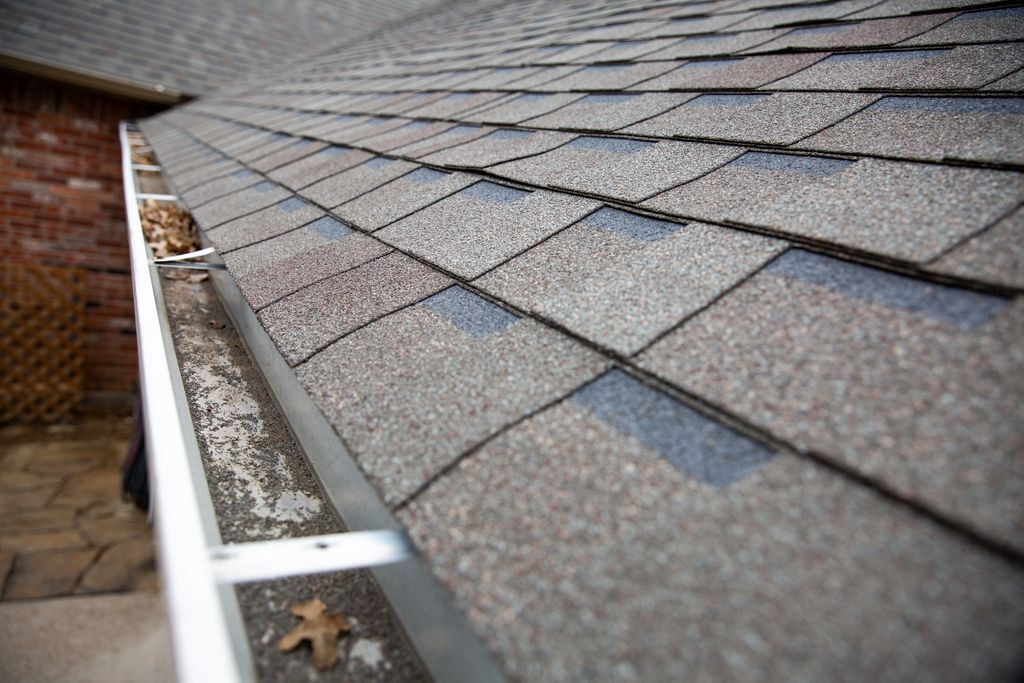 Granules from failing shingles that collect in roof gutters are an indicator of a roof that may need replacement. A lawsuit raises questions about USAA's promised commitment to its customers.