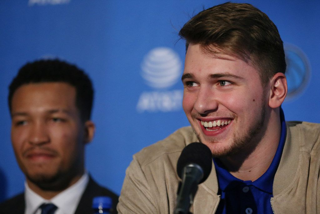 New Dallas Mavericks player Luka Doncic speaks while he is introduced with Jalen Brunson (left) at the American Airlines Center in Dallas Friday June 22, 2018. Doncic was drafted by the Atlanta Hawks with the third overall pick of the 2018 National Basketball Association draft and traded for the Dallas Mavericks fifth overall draft pick Trae Young. (Andy Jacobsohn/The Dallas Morning News)