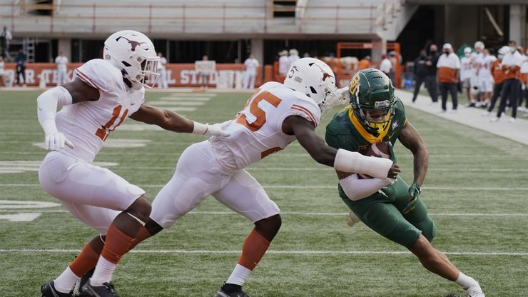 Baylor's Gavin Holmes (6) runs past Texas' B.J. Foster (25) and Anthony Cook (11) for a touchdown during the second half of an NCAA college football game in Austin, Texas, Saturday, Oct. 24, 2020. (AP Photo/Chuck Burton)
