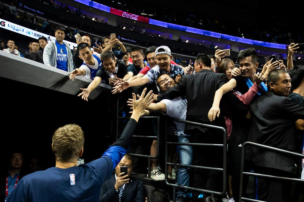 Dallas Mavericks forward Dirk Nowitzki high-fives fans as he leaves the court following an NBA China Games 2018 preseason basketball game against the Philadelphia 76ers at Mercedes-Benz Arena on Friday, Oct. 5, 2018, in Shanghai. (Smiley N. Pool/The Dallas Morning News)