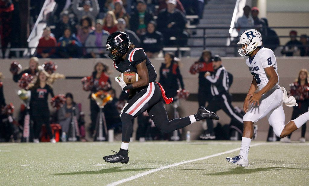 Euless Trinity receiver Jacob Schaeffer (13) catches a long pass as Richland's Da'lon Arthur (8) chases him, during the first half of their high school football game on Friday Nov. 8, 2019. (Michael Ainsworth/Special Contributor)