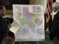 Sen. Jose Rodriguez, left, and Sen. Steve Ogden are shown in front of a map showing U.S. Congressional districts in Texas during debate on a redistricting bill in the Senate on Monday, June 6, 2011, in Austin, Texas.