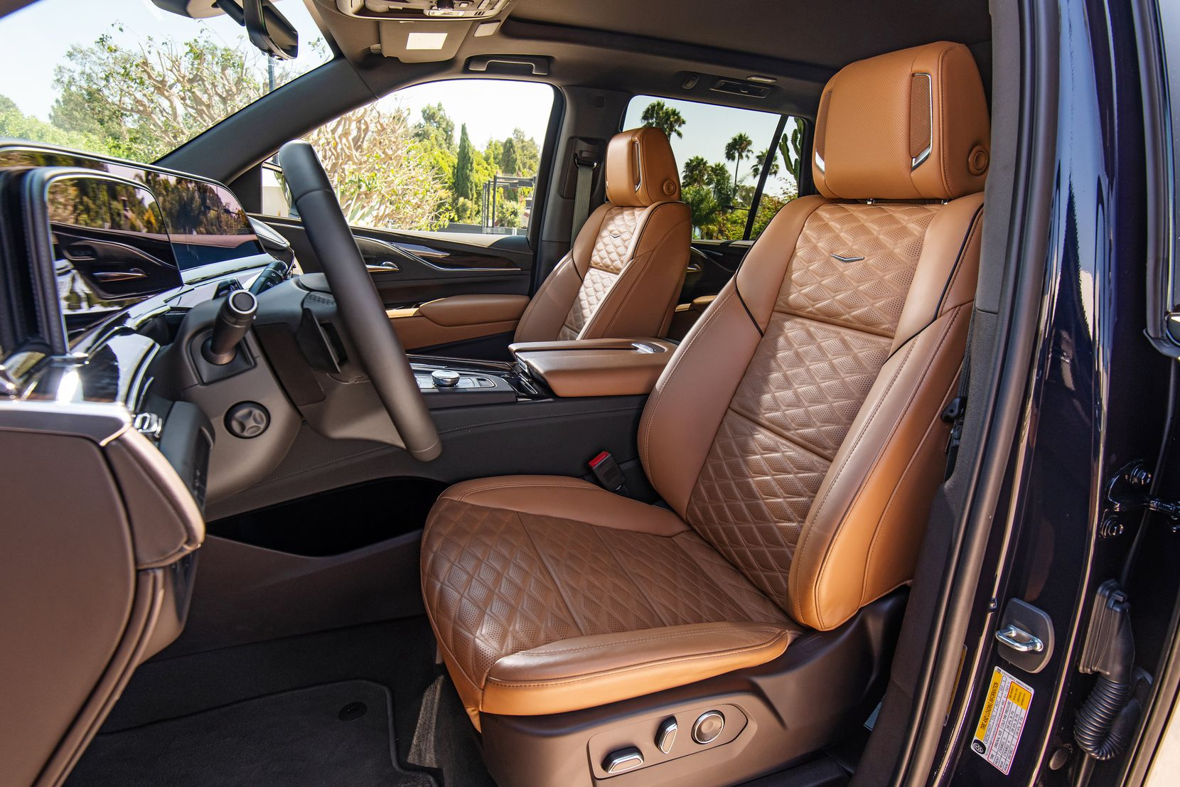 The 2021 Cadillac Escalade Brandy interior with Very Dark Atmosphere accents and full leather seats with faceted quilting.