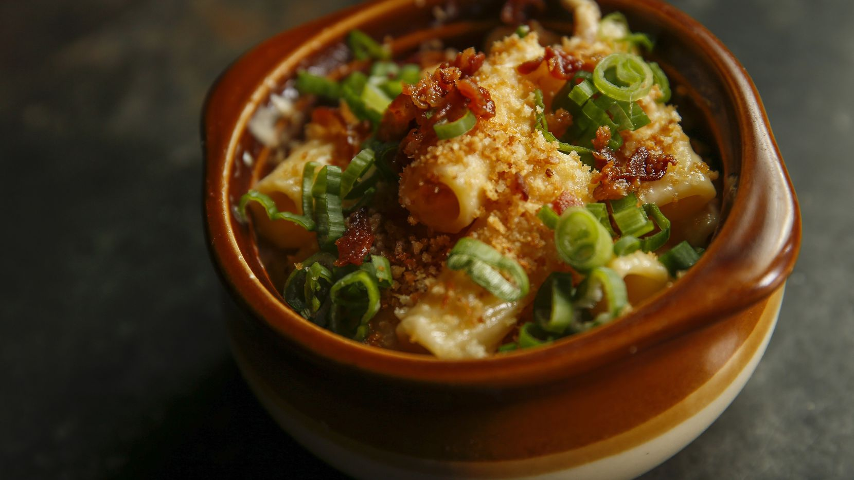 Rigatoni is topped with bacon crumbles, green onions and toasted panko breadcrumbs in Brick and Bones' habanero mac and cheese. (Ryan Michalesko/Staff Photographer)
