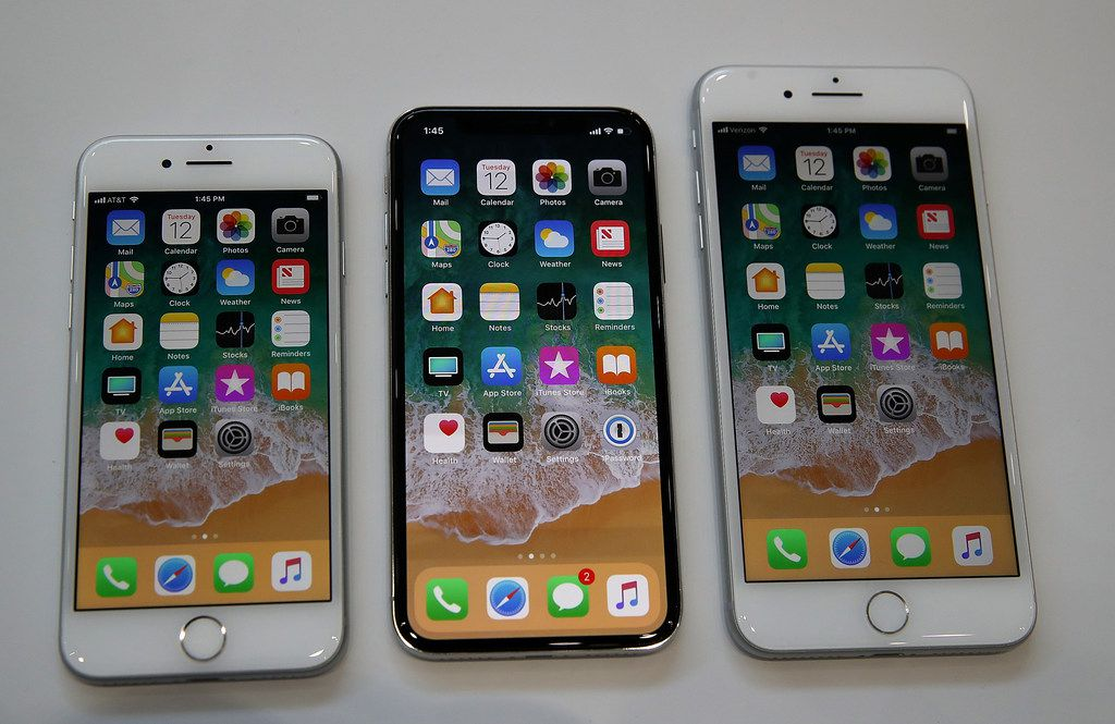From left: The new iPhone 8, iPhone X and iPhone 8S are displayed during an Apple special event Tuesday in Cupertino, Calif.