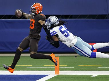 Cleveland Browns wide receiver Odell Beckham Jr. (13) crosses the goal line for a long forth quarter touchdown as Dallas Cowboys middle linebacker Jaylon Smith (54) hangs on at AT&T Stadium in Arlington, Texas, Sunday, October 4, 2020. The touchdown sealed the Browns win over the Cowboys, 48-39.