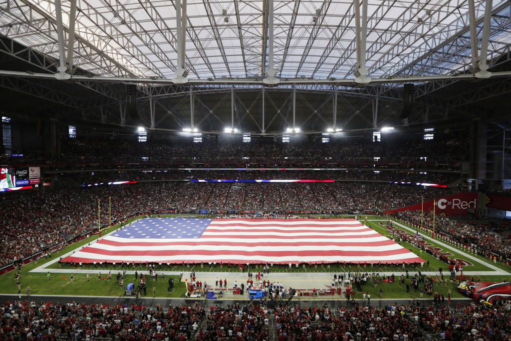 A field-sized flag is displayed during the National Anthem prior to the start of a game between the Dallas Cowboys and Arizona Cardinals at University of Phoenix Stadium in Glendale, Arizona on Monday, September 25, 2017. (Vernon Bryant/The Dallas Morning News)