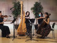 Presented by Fine Arts Chamber Players, violinist Julia Choi, harpist and artistic director Emily Levin, and cellist Jennifer Choi record Henriette Renié's Trio for Harp, Violin and Cello, at the Sammons Center for the Arts in Dallas, on April 21.