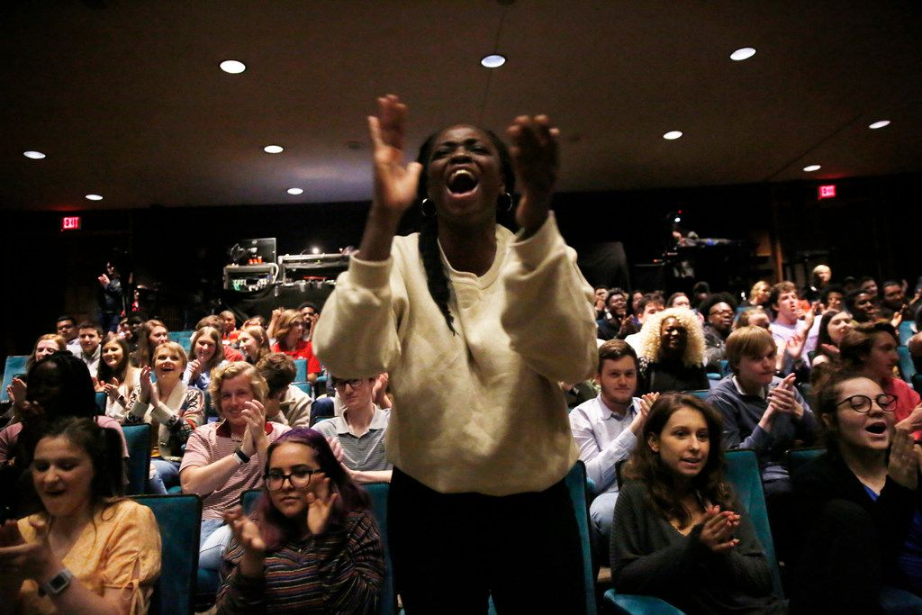 Mary Ukiri, a junior at Lake Highlands High School, cheers for her classmate as he performs during a Hamilton Education Program event at the Music Hall at Fair Park in 2019.
