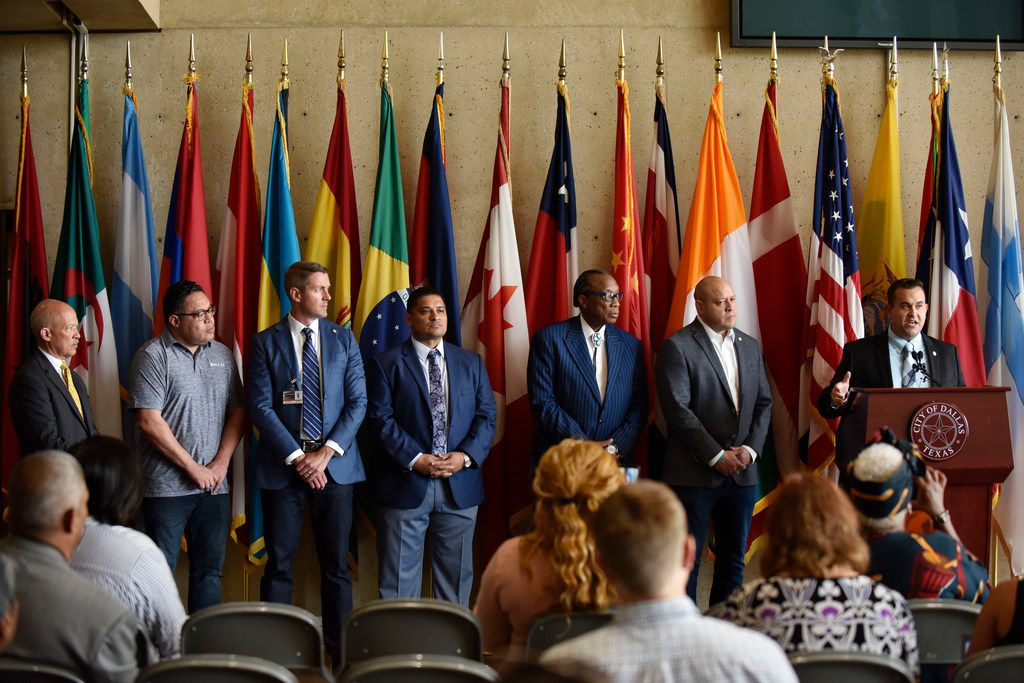 From left: Dallas County DA John Creuzot; Dallas City Council members Omar Narvaez, Chad West and Jaime Resendez; Dallas County Commissioner John Wiley Price; and council members Adam Medrano and Adam Bazaldua at Thursday's press conference in Dallas City Hall's Flag Room.
