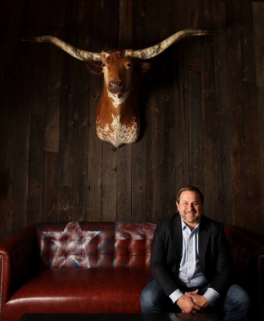Sir Loin, the longhorn on the wall, watches over Haywire in Plano. So does Brian Knoy, right, general manager.