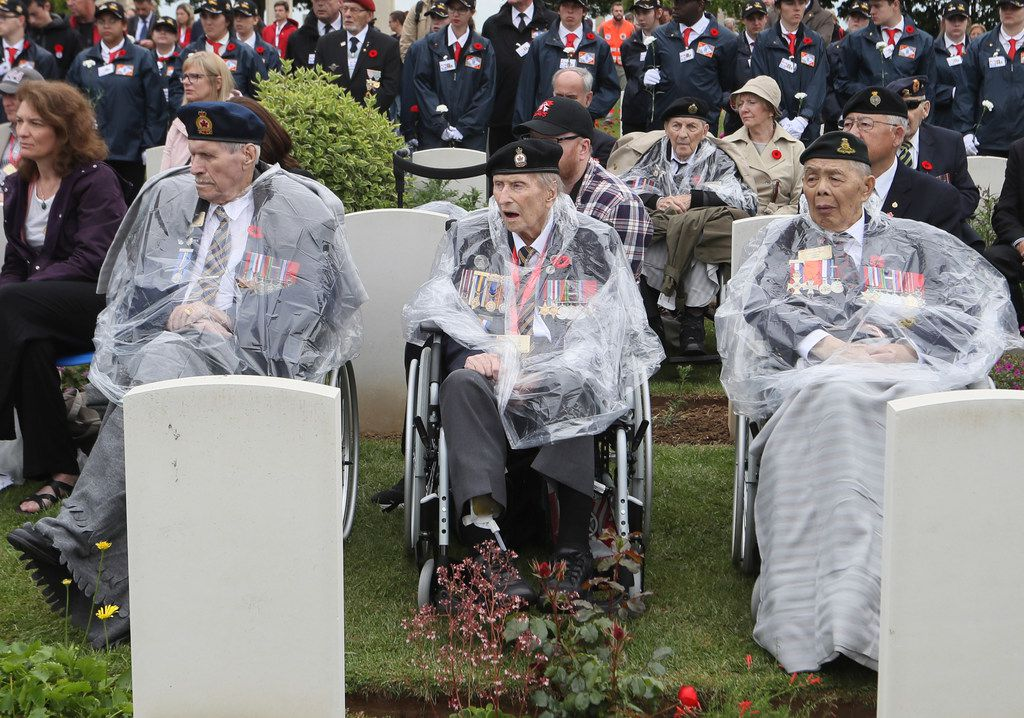 Canadian World War II veterans and other guests attend a ceremony at the Beny-sur-Mer Canadian War Cemetery in Reviers, Normandy, France, Wednesday, June 5, 2019. A ceremony was held on Wednesday for Canadians who fought and died on the beaches and in the bitter bridgehead battles of Normandy during World War II.