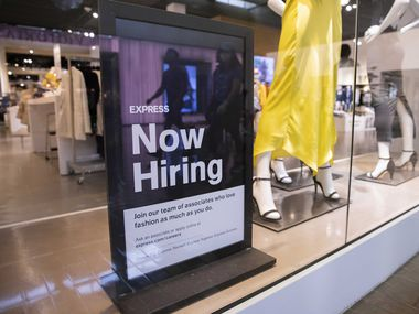 A hiring sign at the Express store at NorthPark Center in Dallas.