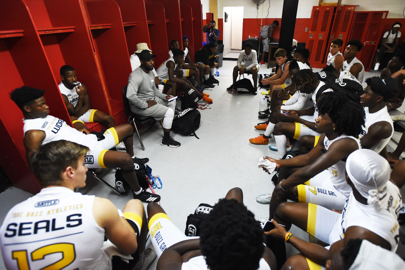 True Buzz coach Bryan Leonard gives a talk to his players in the locker room prior to the Pylon 7v7 National Championship event held at Woodward Academy in Atlanta, Georgia, on May 26, 2019.  ORG XMIT: 10045505A