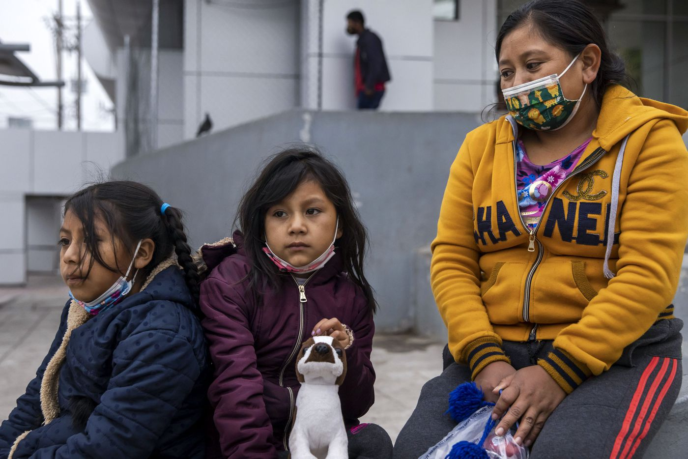 """Isabela Julaj, right, sits with her daughters Yésica, (center) 7, and Maria Francela, 8, along with other migrant families stranded in the plaza near the international bridge leading into Reynosa, in Mexico. The three were expelled from the United States overnight under Title 42 — a pandemic-related public order still in place and left over from the Trump administration. The single mother of two said she feels she has no choice but to return to Guatemala. """"There's nothing left for me to do,"""" Julaj said. """"I have very little money left."""""""