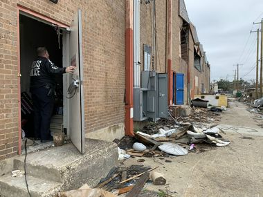 Dallas Police Lt. Kevin Campbell enters the unsecured back door to a pawn shop in the Marsh Lane Plaza shopping center walloped by the Oct. 20, 2019, tornado.