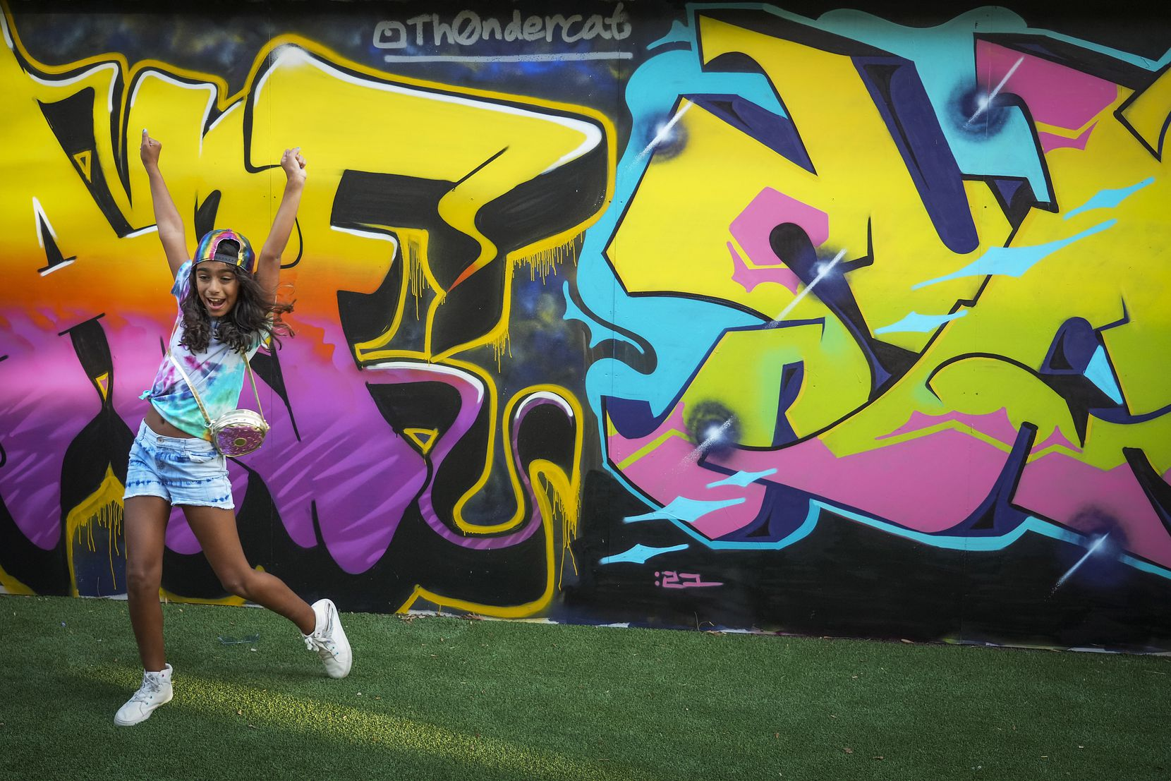 Farah Herrera, 10, celebrates while playing lawn games at ArtPark in Trinity Groves.