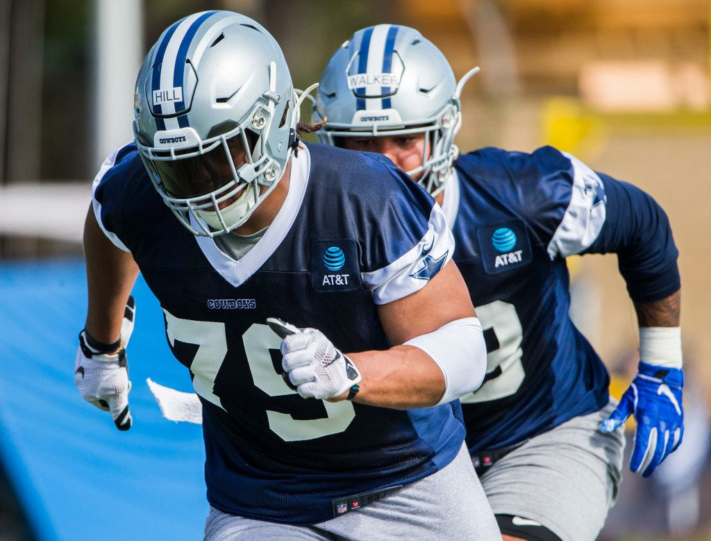 Dallas Cowboys defensive tackle Trysten Hill (79) and tight end Dalton Schultz (86) run a drill during an afternoon practice at training camp in Oxnard, California on Sunday, July 28, 2019. (Ashley Landis/The Dallas Morning News)