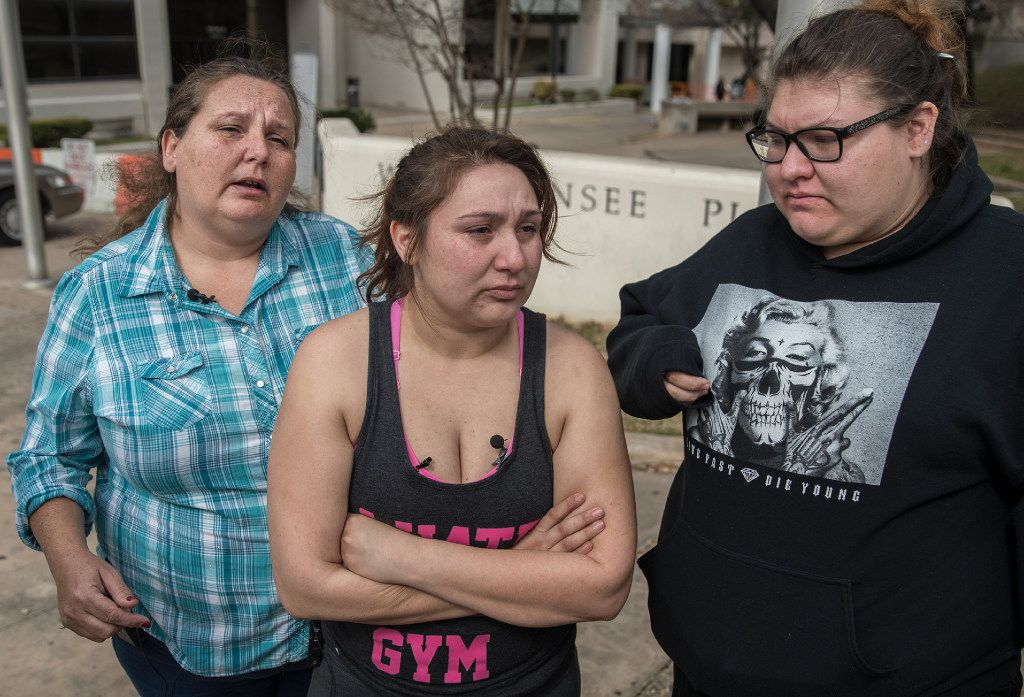 Angel Velazquez (center), with her mother and sister, spoke to reporters about how agents with U.S. Immigration and Customs Enforcement arrested her fiancé Hugo Baltazar Ramirez on Friday in Austin.