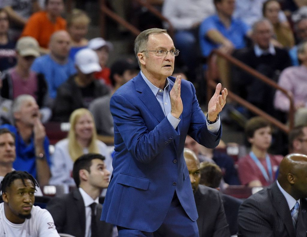 Oklahoma coach Lon Kruger applauds his team during the second half of a second-round men's college basketball game against Virginia in the NCAA Tournament in Columbia, S.C., Sunday, March 24, 2019. (AP Photo/Richard Shiro)