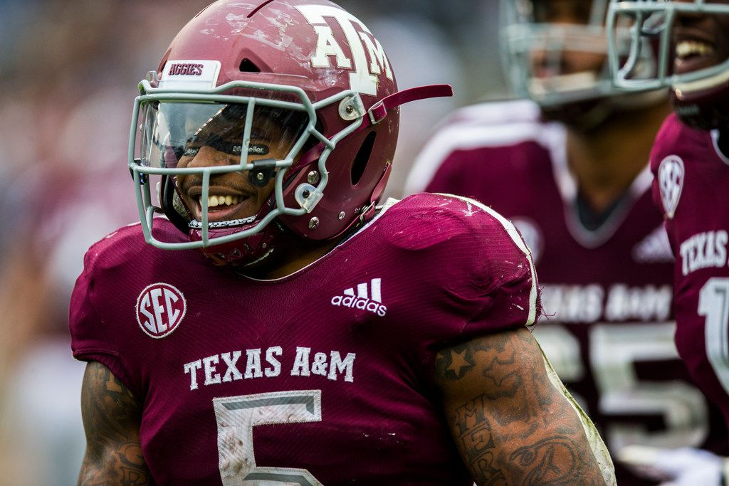 Texas A&M Aggies running back Trayveon Williams (5) celebrates after running to the end zone for a touchdown during the fourth quarter of a college football game between Texas A&M and Ole Miss on Saturday, November 9, 2018 at Kyle Field in College Station, Texas. (Ashley Landis/The Dallas Morning News)
