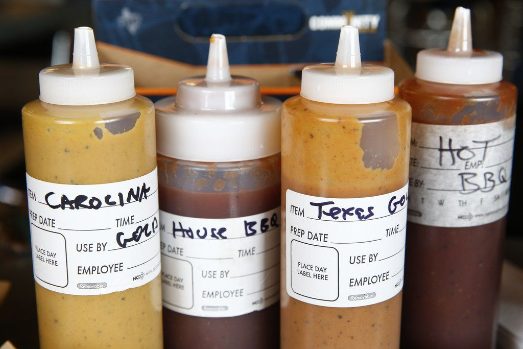 The variety of sauces served at Ferris Wheelers Backyard & BBQ in Dallas on Sept. 25, 2017.   (Nathan Hunsinger/The Dallas Morning News)
