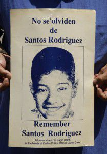 An old poster of Santos Rodriguez from 1993 displays his image for a community memorial.