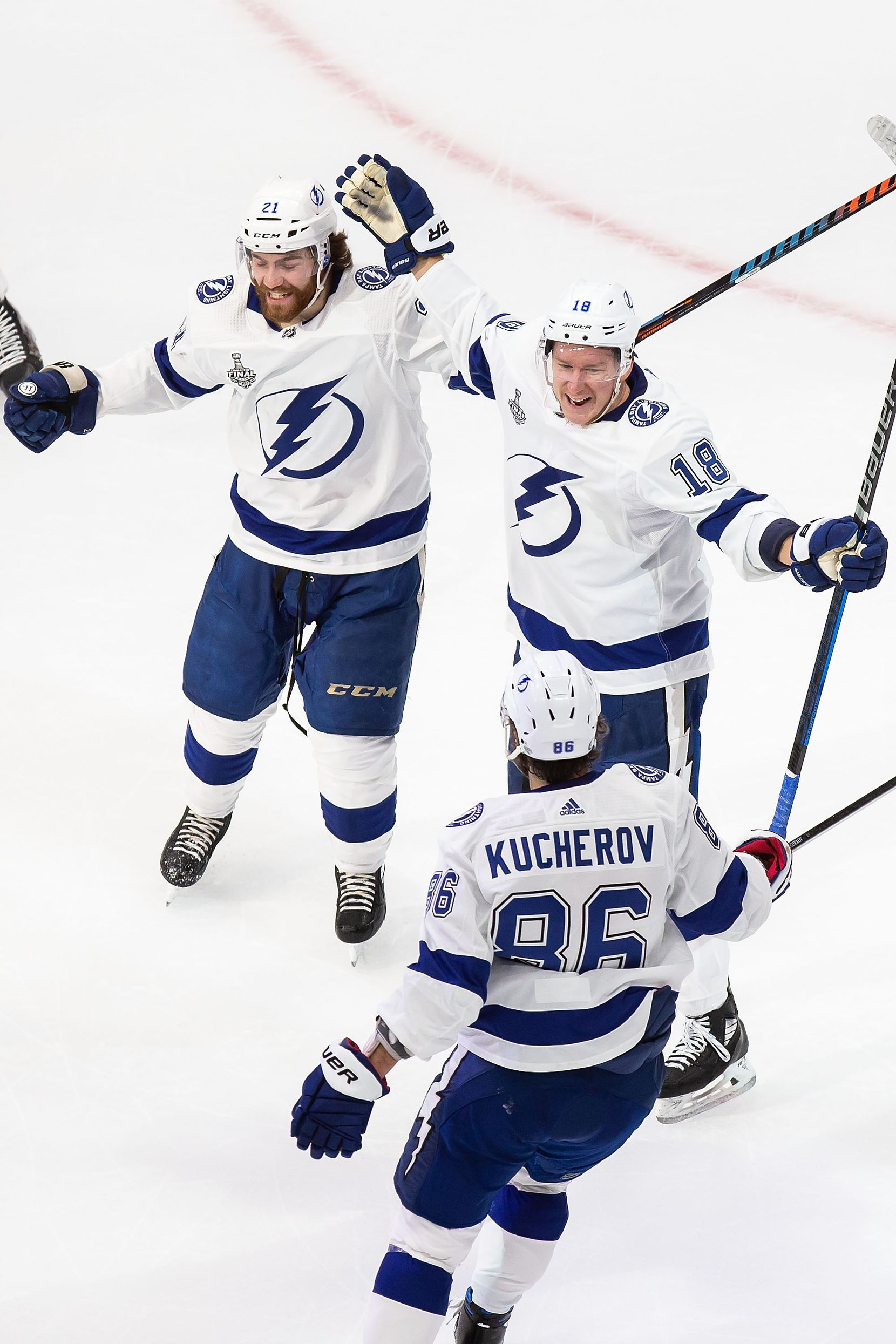 Brayden Point (21), Ondrej Palat (18) and Nikita Kucherov (86) of the Tampa Bay Lightning celebrate Palat's goal against the Dallas Stars during Game Three of the Stanley Cup Final at Rogers Place in Edmonton, Alberta, Canada on Wednesday, September 23, 2020. (Codie McLachlan/Special Contributor)