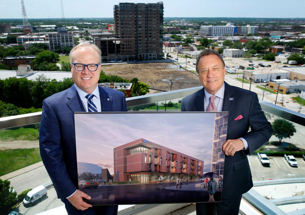 Jim Hinton, CEO of Baylor Scott & White Health (left) and Jeff Fehlis, executive vice president of the American Cancer Society South Region, pose with a rendering of the Gene and Jerry Jones Family Hope Lodge.