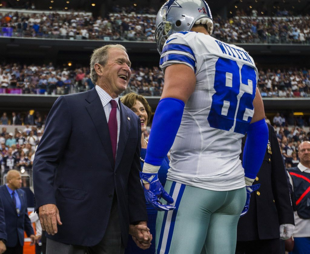 Former President George W. Bush and former First Lady Laura Bush greet Dallas Cowboys tight end Jason Witten (82) as they join the Dallas Cowboys and New York Giants on the field for the coin toss before their game on Sunday, September 11, 2016 at AT&T Stadium in Arlington, Texas. (Ashley Landis/The Dallas Morning News)
