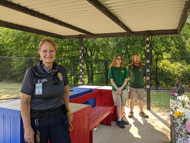 Allen Animal Control Supervisor Deborah Michnick, Ethan Garner and Michael Garner pose for a photo with the new renovated benches.